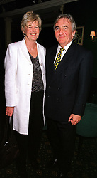 MR & MRS BOB MARSHALL-ANDREWS he is the MP and QC, at a dinner in London on 23rd February 2000.OBM 40