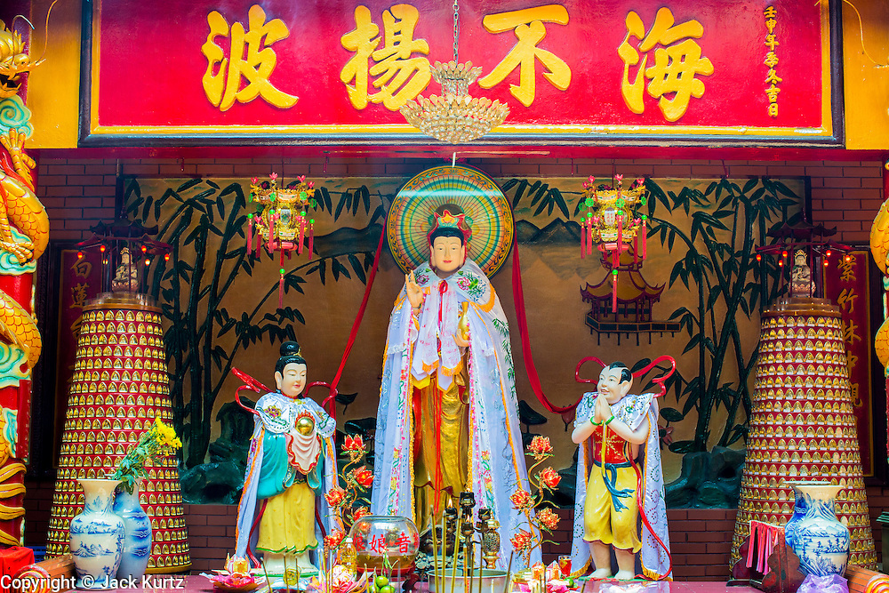"""12 APRIL 2012 - HO CHI MINH CITY, VIETNAM: An alter in Chùa Quan Âm (Avalokiteshvara Pagoda), a Chinese style Buddhist pagoda in Cho Lon. Founded in the 19th century, it is dedicated to the bodhisattva Quan Âm. The pagoda is very popular among both Vietnamese and Chinese Buddhists. Cholon is the Chinese-influenced section of Ho Chi Minh City (former Saigon). It is the largest """"Chinatown"""" in Vietnam. Cholon consists of the western half of District 5 as well as several adjoining neighborhoods in District 6. The Vietnamese name Cholon literally means """"big"""" (lon) """"market"""" (cho). Incorporated in 1879 as a city 11km from central Saigon. By the 1930s, it had expanded to the city limit of Saigon. On April 27, 1931, French colonial authorities merged the two cities to form Saigon-Cholon. In 1956, """"Cholon"""" was dropped from the name and the city became known as Saigon. During the Vietnam War (called the American War by the Vietnamese), soldiers and deserters from the United States Army maintained a thriving black market in Cholon, trading in various American and especially U.S Army-issue items.          PHOTO BY JACK KURTZ"""