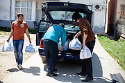 Sandwiches, children books and hygenic things such as diapers are prepared and loaded to the car for delivery to Crnik where Romina will have her lecture the same day. Left Elvis Kovacev, right project coordinator Zoran Bikovsky.