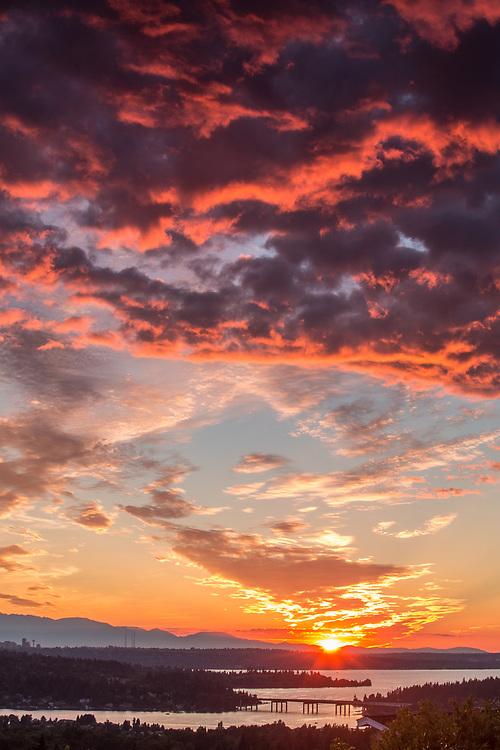 United States, Washington, Lake Washington, Seattle and Olympic Mountains viewed from Bellevue at sunset.