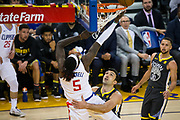 Golden State Warriors center Zaza Pachulia (27) fouls LA Clippers forward Montrezl Harrell (5) during a layup at Oracle Arena in Oakland, California, on February 22, 2018. (Stan Olszewski/Special to S.F. Examiner)