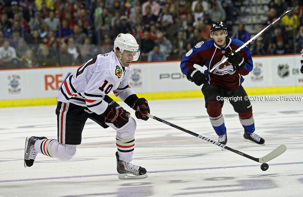 DENVER, CO - OCTOBER 7: Kyle Cumiskey (#10) of the Colorado Avalanche tries to chase down Patrick Sharp (#10) of the Chicago Blackhawks during both team's season openers at the Pepsi Center on October 7, 2010 in Denver, Colorado. (Photo by Marc Piscotty / © 2010)