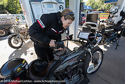 Chris Sommer Simmons of Hawaii fuels up her 1915 Harley-Davidson during the Motorcycle Cannonball Race of the Century. Stage-3 from Morgantown, WV to Chillicothe, OH. USA. Monday September 12, 2016. Photography ©2016 Michael Lichter.
