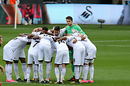 Lukasz Fabianski, the Swansea city goalkeeper ® looks on from the prematch Swansea city players huddle. Premier league match, Swansea city v Huddersfield Town at the Liberty Stadium in Swansea, South Wales on Saturday 14th October 2017.<br /> pic by  Andrew Orchard, Andrew Orchard sports photography.