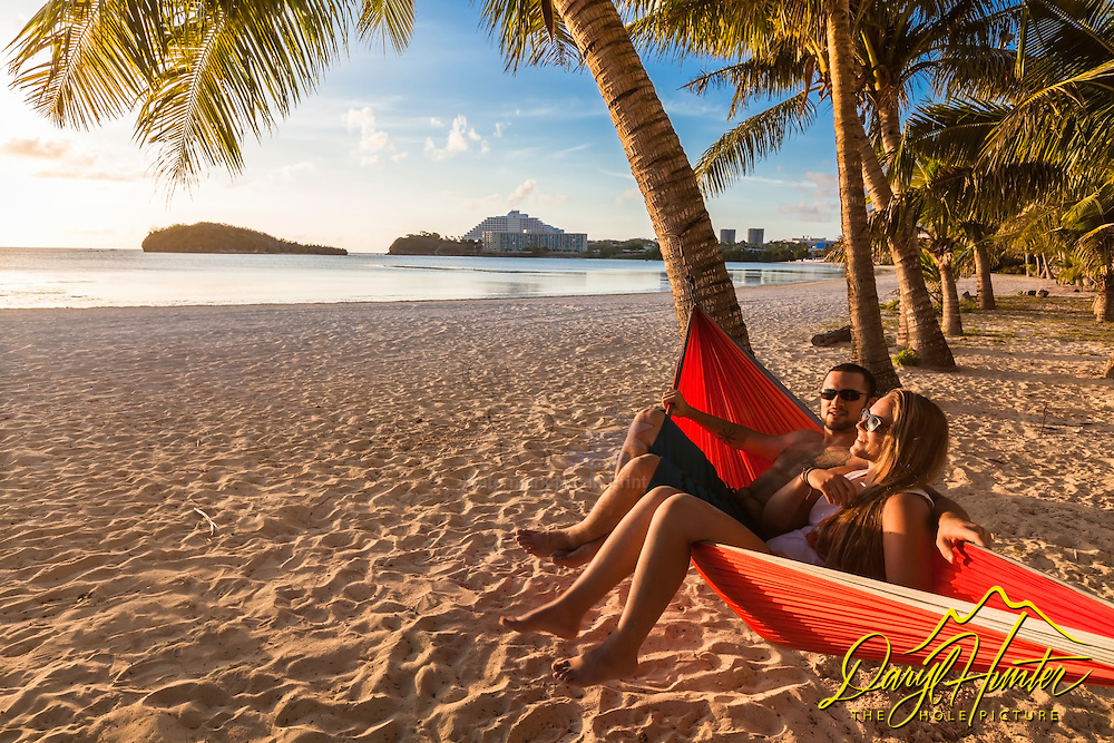 Young lovers enjoying a tropical evening on  the island paradise of Guam in the Mariana Islands.