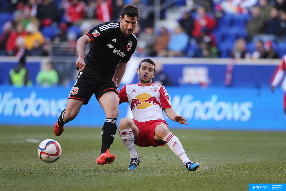 Chris Pontius, (left),  D.C. United is challenged by Felipe Martins, New York Red Bulls, during the New York Red Bulls Vs D.C. United Major League Soccer regular season match at Red Bull Arena, Harrison, New Jersey. USA. 22nd March 2015. Photo Tim Clayton