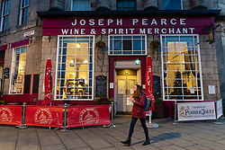 Edinburgh, Scotland, UK. 14 December 2020. City of Edinburgh controversially remains in Level 3 of lockdown meaning bars and restaurants must close at 6pm and not sell alcohol. Most bars have chosen to remain closed, Tuesday will see Scottish Government announce if the city will relax lockdown to level 2 or remain at level 3. Pic; Joseph Pearce pub offers takeaway drinks. Iain Masterton/Alamy Live News