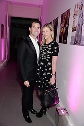 JIMMY CARR and KAROLINE COPPING at a party to launch the Autumn/Winter 2013 Candy Magazine held at The Saatchi Gallery, Duke of York's HQ, King's Road, London on 15th October 2013.