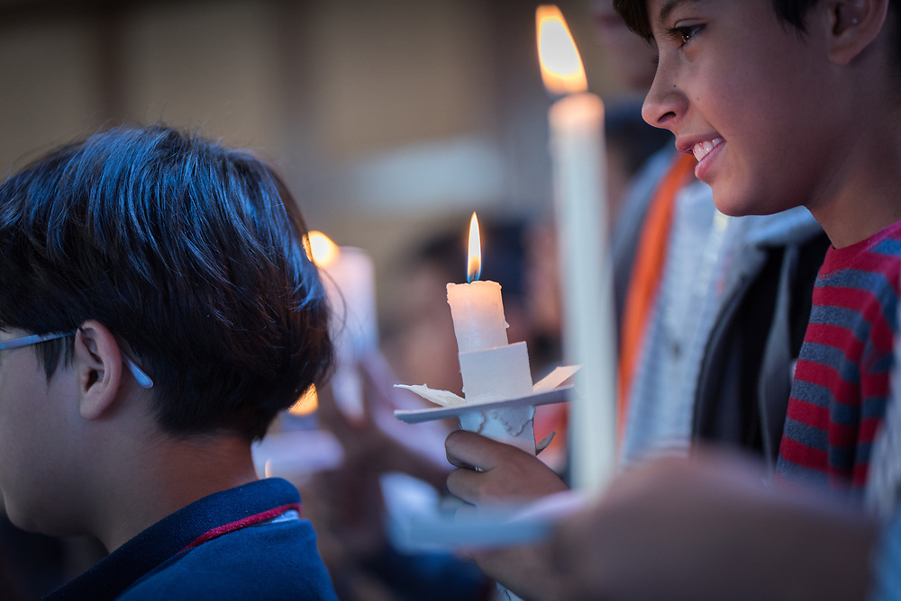 18 November 2018, Bogotá, Colombia: School children lead a candle light ceremony. The church of San Lucas ('Saint Lucas') of the Evangelical Lutheran Church of Colombia, brings together a congregation of some 100 people in the southern areas of Bogotá. Located in the Kennedy area, the church has recently celebrated 50 years. As part of its ministry, the church runs a school and college, The Colegio Evangelico Luterano de Colombia (CELCO) San Lucas, offering education to just over 1,000 students aged 3-18. The school started as a social initiative offering care for children aged 0-4 in Bogotá's less wealthy neighbourhood, allowing the parents opportunities to go to work. 36 years after its foundation, the school employs 56 staff, of which 36 are teachers.