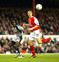 Photo. Chris Ratcliffe, Digitalsport<br /> Arsenal v Stoke City. FA Cup Third Round. <br /> 09/01/2005<br /> Ade Akinbiyi of Stoke and Phillippe Senderos of Arsenal watch the ball closely at Highbury as Arsenal win 2-1.