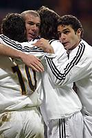 29/2/2004 Madrid, Spain.<br />La Liga (Spanish League) 26 day.<br />R.Madrid 4 - Celta 2<br />R.Madrid's Zidane celebrates with Figo, Solari and Nunez at Santiago Bernabeu's Stadium.