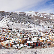 A high resolution composite of 9 images create a panoramic of Park City, Utah in the winter on a day of fresh snow and blue skies, and showcases Park City Mountain Resort and Old Town.