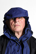 portrait of a senior man wearing a parka