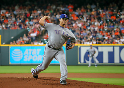 July 28, 2018 - Houston, TX, U.S. - HOUSTON, TX - JULY 28:  Texas Rangers starting pitcher Ariel Jurado (57) pitches to Houston Astros catcher Max Stassi (12) in the bottom of the second inning during the baseball game between the Texas Rangers and Houston Astros on July 28, 2018 at Minute Maid Park in Houston, Texas.  (Photo by Leslie Plaza Johnson/Icon Sportswire) (Credit Image: © Leslie Plaza Johnson/Icon SMI via ZUMA Press)