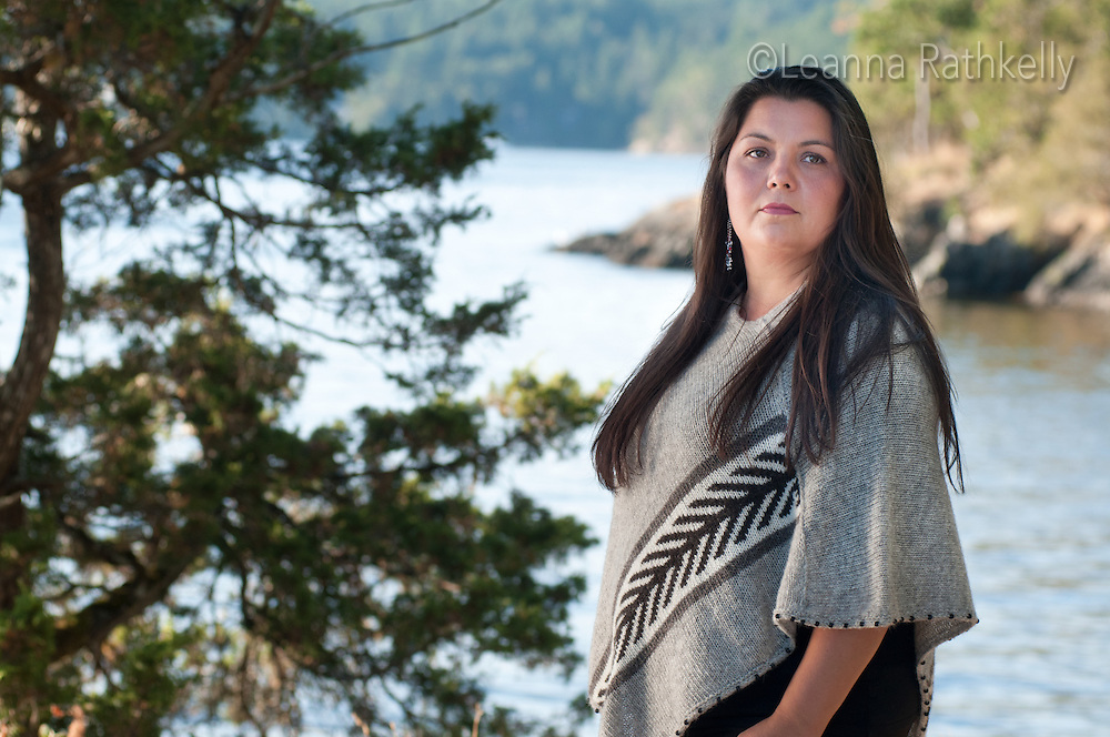 An outdoor portrait of Joni Olsen of the Tsartlip first Nation, near Brentwood Bay, BC. Joni wears and designs traditional and contemporary versions of the Cowichan sweater.
