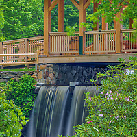 Covered Enchnata Bridge, rhododendron and waterfall photography at the Major Willard Moore State Park in Paxton, Massachusetts. The historic Enchnata Bridge was recently rebuilt and restored and it looks absolutely beautiful.<br /> <br /> Major Willard Moore State Park Covered Enchanta Bridge photography images are available as museum quality photography prints, canvas prints, acrylic prints, wood prints or metal prints. Fine art prints may be framed and matted to the individual liking and decorating needs:<br /> <br /> https://juergen-roth.pixels.com/featured/major-willard-moore-state-park-covered-enchanta-bridge-juergen-roth.html<br /> <br /> Good light and happy photo making!<br /> <br /> My best,<br /> <br /> Juergen