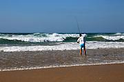 Man fishing from the beach at Conil de la Frontera, Cadiz province, Spain