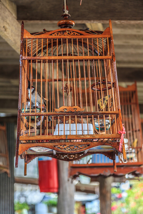A birdcage hangs in Koh Panyee village in Phang Nga Bay, Thailand.