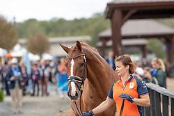 Groom running with, Voets Sanne, NED, Demantur<br /> World Equestrian Games - Tryon 2018<br /> © Hippo Foto - Dirk Caremans<br /> 17/09/2018
