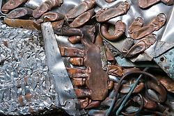 Close up of crushed aluminium and copper radiators at a metal recycling centre,