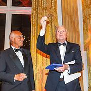 NLD/Amsterdam/20150511 - uitreiking Libris Literatuurprijs 2015, winnaar Adriaan van Dis krijgt de prijs en penning van Paul Kleyngeld