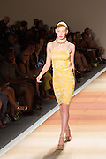 A pastel yellow print dress with spaghetti straps.