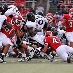 Sep 7, 2009; Piscataway, NJ, USA; Cincinnati defensive back Chris Williams (20) is denied a second half touchdown as Cincinnati defeats Rutgers 47-15 in NCAA Big East football at Rutgers Stadium.