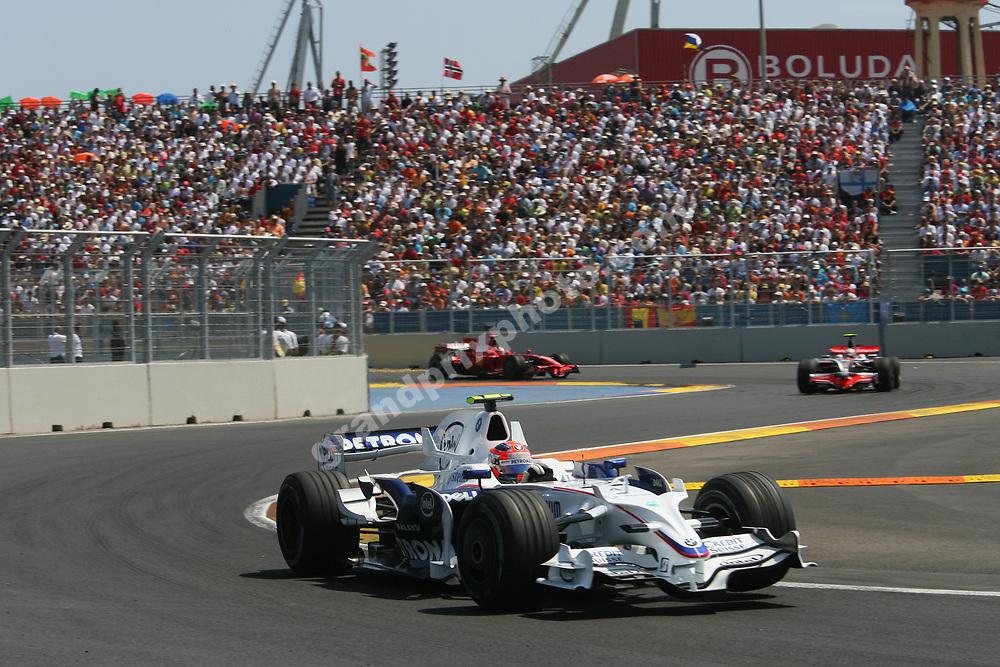 Robert Kubica (BMW) leads Heikki Kovalainen (McLaren-Mercedes) and Kimi Raikkonen (Ferrari) in the 2008 European Grand Prix in Valencia. Photo: Grand Prix Photo