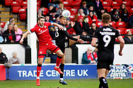 Barnsley forward Jacob Brown (33) and Walsall FC defender Luke Leahy (3) during the EFL Sky Bet League 1 match between Walsall and Barnsley at the Banks's Stadium, Walsall, England on 23 March 2019.