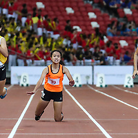 Raine Oh (#99) of Singapore Sports School stumbles, as Bernice Liew (#421) and Elizabeth-Ann Tan (#430) of Nanyang Girls' High go on to finish in first and second place in the B Division girls' 100m final. (Photo © Lim Yong Teck/Red Sports)