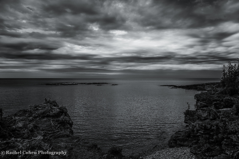 """""""Skies over Presque Isle""""<br /> <br /> A beautiful black and white photograph of storm clouds over Lake Superior and Presque Isle Park in Marquette, Michigan!"""
