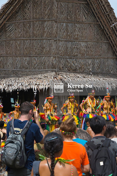 Tourists watching Yapese girls in traditional clothing performing at Yap Day Festival, Yap Island, Federated States of Micronesia