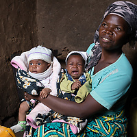 Noella Kanyere with her twins. Noella lives near Butembo, Congo, at a site where IMA and Tearfund supported the construction of basic water infrastructure for the community.