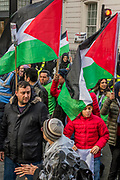 National Palestine March and Rally - Justice Now: Make it right for Palestine. As the centenary of the Balfour Declaration has just passed on the 2nd November. Speakers addressed the crowd at Grosvenor Square (by the US Embassy) before the march through central London (via Piccadilly Circus and Trafalgar Square). This was followed by a rally in Parliament Square, where speakers again addressed the crowd. London  4 November 2017.