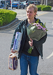 ©Licensed to London News Pictures 22/03/2020<br /> Locksbottom, UK Mothers day shopping done for this young man Flowers,bread and toilet roll. Early Sunday morning shoppers at a Sainsburys store in South East London. Coronavirus outbreak.  Photo credit: Grant Falvey/LNP