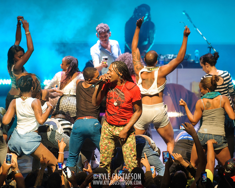 "WASHINGTON, DC - October 2nd, 2014 - Big Freedia (center, with mic) performs at the Howard Theatre in Washington, D.C.  Freedia is credited with bringing New Orleans ""bounce music"" to the masses. His latest album, Just Be Free, was released in June. (Photo by Kyle Gustafson/For The Washington Post)"