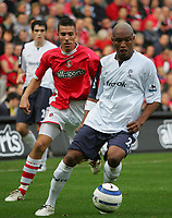 Photo: Frances Leader.<br />Charlton Athletic v Bolton Wanderers. The Barclays Premiership. 29/10/2005.<br /><br />Bolton's El Hadji Diouf with the ball against Charlton's Darren Ambrose.