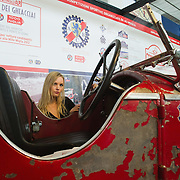 PADOVA, ITALY - OCTOBER 27:  A model looks at the interior of a vintage Alfa Romeo car on October 27, 2011 in Padova, Italy. The Vintage and Classic Cars Exhibition of Padova, running from the October 28 - 30, is the most important European trade show for vintage cars and motorbikes, showcasing over 1600 vehicles.