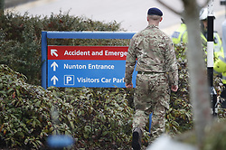 © Licensed to London News Pictures. 09/03/2018. Salisbury, UK. Military personnel arrive at Salisbury District hospital. Former Russian spy Sergei Skripal and his daughter Yulia are critically ill after being poisoned with nerve agent. The couple where found unconscious on bench in Salisbury shopping centre. A policeman who went to their aid is recovering in hospital. Photo credit: Peter Macdiarmid/LNP