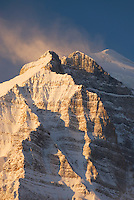 Winter sunrise sets the snow covered slopes of Mount Temple aglow, Banff National Park Alberta Canada