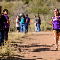 Miyamura Patriot Ashley Thomas runs to the finish line in second place during the varsity race at the Grants High School Invitational cross country meet in Grants Friday.