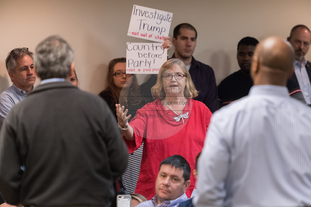 A woman expresses her concerns about the elimination of Obamacare to U.S. Sen. Tim Scott, right, and U.S. Rep. Mark Sanford during a town hall meeting February 18, 2017 in Mount Pleasant, South Carolina. Hundreds of concerned residents turned up for the meeting to address their opposition to President Donald Trump during a vocal meeting held by U.S. Rep. Mark Sanford and Senator Tim Scott.