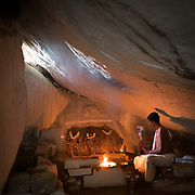 In one of Hampi small temple, a pilgrim prays.