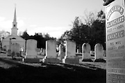 Headstones cast long shadows in an old cemetery near Searsport, Maine.