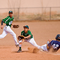 030513       Cable Hoover<br /> <br /> Window Rock Scout Jason Kaulity (42) steals second base ahead of the throw to Tuba City Warrior Roland Becenti (6) Tuesday at Window Rock High School.