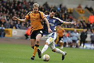 Coca Cola championship, Wolverhampton Wanderers v Cardiff City on Sunday 22nd Feb 2009 . pic by Andrew Orchard, Andrew Orchard sports photography, Cardiff City's Joe Ledley goes past David Edwards of Wolves.