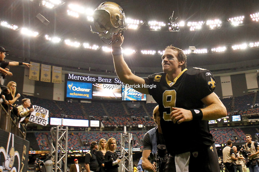 December 4, 2011; New Orleans, LA, USA; New Orleans Saints quarterback Drew Brees (9) celebrates as he leaves the field following a win over the Detroit Lions at the Mercedes-Benz Superdome. The Saints defeated the Lions 31-17. Mandatory Credit: Derick E. Hingle-US PRESSWIRE