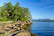 A Park bench along the shore of Biggs Park in Nanaimo, British Columbia, Canada