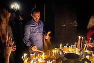 Sako, a Syrian-Armenian, lights candles after the Easter service at St Gregory's Cathederal in Armenia's capital, Yerevan. He arrived in Armenia from Aleppo in September 2012 when violence struck his neighbourhood in the city.