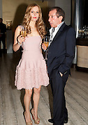 EVITA ABLOGINA; JIMMY LA HOOD, The Tomodachi ( Friends) Charity Dinner hosted by Chef Nobu Matsuhisa in aid of the Unicef  Japanese Tsunami Appeal. Nobu Berkeley St. London. 5 May 2011. <br /> <br />  , -DO NOT ARCHIVE-© Copyright Photograph by Dafydd Jones. 248 Clapham Rd. London SW9 0PZ. Tel 0207 820 0771. www.dafjones.com.